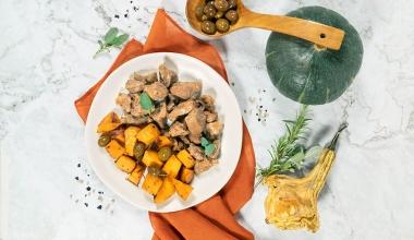 Spezzatino di vitello con zucca e olive al forno